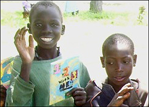 Boys with a book from U.S. students.