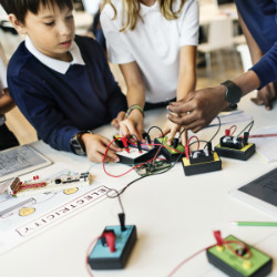 Kids using a makerspace in a library