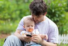 Father and baby with cellphone