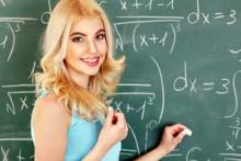 girl doing a math problem on the board