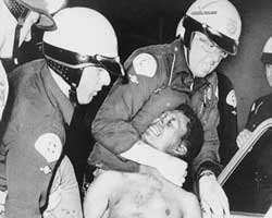 Police arrest a man during the 1965 Watts riots